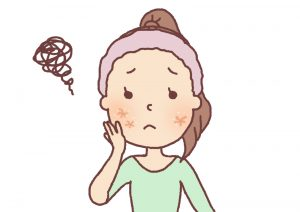 アトピー性皮膚炎に悩んでいる女性の画像